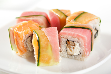 sake: Rainbow Maki Sushi - Roll with Eel and Cream Cheese inside. Tuna, Salmon and Avocado outside