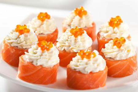 philadelphia roll: Maki Sushi - Philadelphia Roll made of Cream Cheese  inside. Fresh Raw Salmon outside Stock Photo