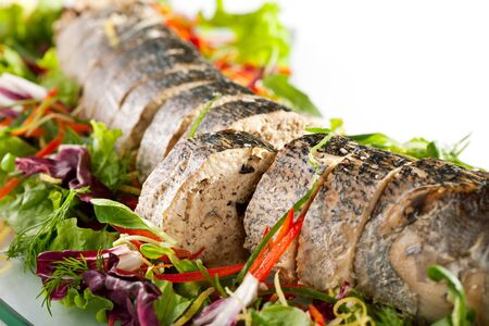 stuffed animals: Stuffed Sliced Pike with Mixed Salad Stock Photo