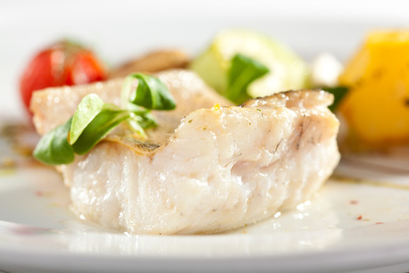 halibut: Halibut Steak with Vegetables and Sauce