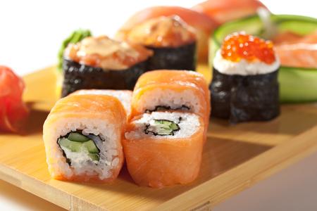 japanese cuisine: Japanese Cuisine - Salmon Sushi Set. Nigiri and Sashimi with Gunkan Maki Sushi with Red Roe
