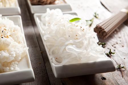 garnish: Various Noodles and Garnish on Wooden Background