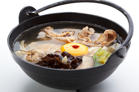 shitake: Pork Soup with Mushrooms (Shitake), Chinese Cabbage, Noodles (Udon), Red Pepper and Egg Yolk