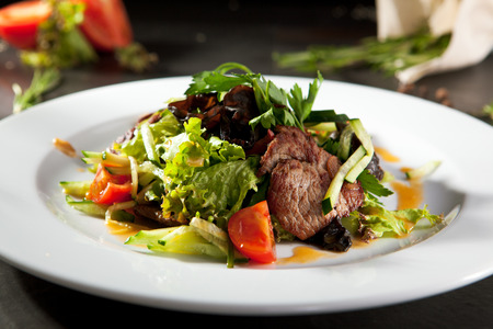 veal: Warm Salad with Spicy Veal Stock Photo