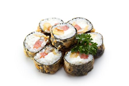 maki sushi: Tempura Maki Sushi - Roll made of Smoked Salmon, Smoked Eel, Pineapple and Cream Cheese inside Stock Photo