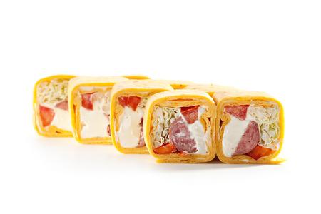 maki sushi: Burrito Maki Sushi - Roll made of Smoked Salmon and Cream Cheese inside. Mexican Pancake outside Stock Photo