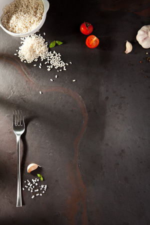 italian: Food Ingredient on Black Slate Background