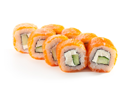Philadelphia Maki Sushi made of Cream Cheese and Cucumber inside. Salmon outside Stock Photo
