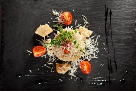 black stone: Gourmet Mushroom Risotto with Parmesan and Cherry Tomato Stock Photo