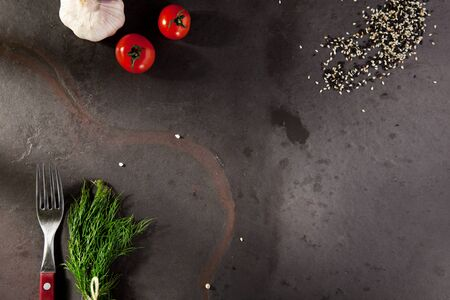 ajonjoli: Dill and Fork on Dark Background