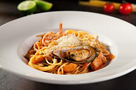 italian cuisine: Seafood Spaghetti with Tiger Prawns, Scallops, Mussels, Calamari, Salmon and Tomato Sauce