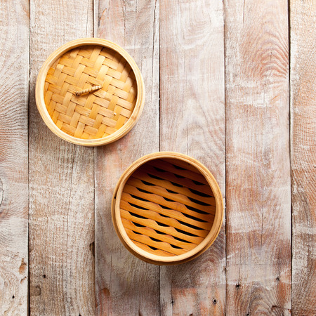 Bamboo Basket Steamer on Wood Background