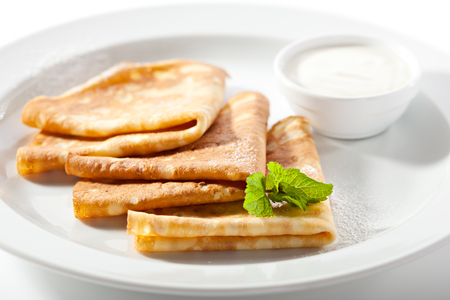 sour cream: Crepes with Sour Cream and Mint Leaf Stock Photo