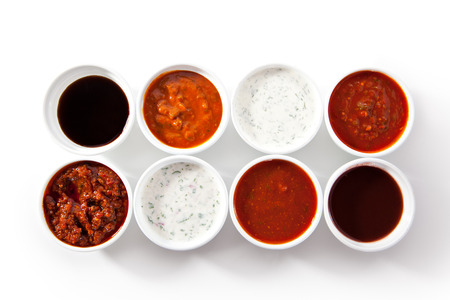 Assorted Spicy Sauces over White Stock Photo - 64185733