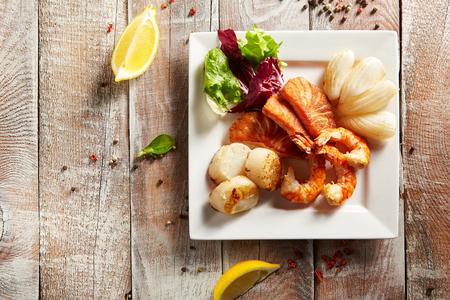 vegetables on white: Grilled Foods - Seafood with Fresh Salad Stock Photo
