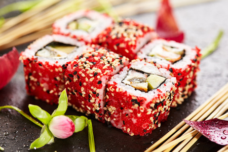 adentro y afuera: Sushi Roll with Shrimp, Smoked Eel, Avocado and Cream Cheese inside. Tobiko and Sesame outside