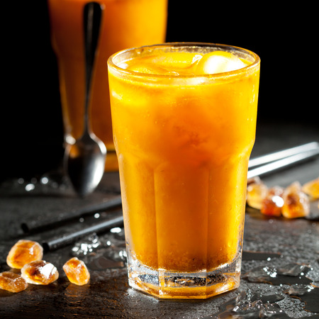 crushed ice: Sea Buckthorn Lemonades with Crushed Ice Stock Photo