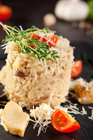 italian cuisine: Gourmet Mushroom Risotto with Parmesan and Cherry Tomato Stock Photo