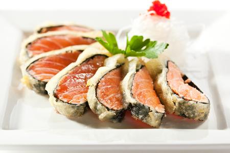 nori: Nori Wrapped Salmon. Garnished with Daikon