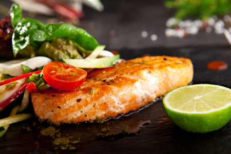 black dish: Grilled Salmon with Vegetables and Lime