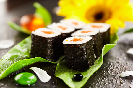 sake maki: Sake Maki - Sushi Roll with Salmon inside. Seaweed outside. Sushi Food and Natural Flower Concept