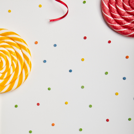 sweet background: Birthday Concept - Holiday Top View Various Sweet Candy on White Background. Fun Decoration. Minimal Holiday Concept. Flat Lay Stock Photo