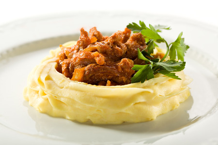 Stewed Meat Served with Mashed Potato Stock Photo