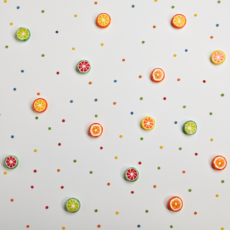 top of the year: Birthday Concept - Holiday Food Top View Various Sweet Candies on White Background. Fun Decoration. Minimal Holiday Concept. Flat Lay Stock Photo