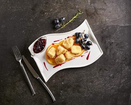 hermelin: Restaurant Food - Deep Fried Camembert with Sweet Berries Sauce Stock Photo
