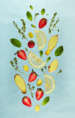 Summer Food and Drink - Fruit Lemonade Ingredient Pattern made of Strawberry, Ginger, Lemon, Fresh Mint and . Splash Shape with Flying Drink Ingredient. Summer Fruit Drink Ingredient Concept. Flat Lay