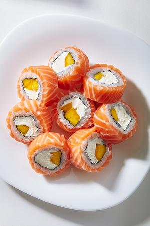 Exotic Philadelphia Sushi Roll -Tropical Maki Sushi with Mango inside and Salmon outside
