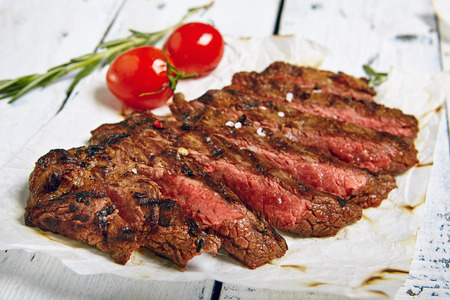 Gourmet Grill Restaurant Beef Steak Menu - Flank Steak on Wooden Background. Beef Steak Dinner Stock fotó