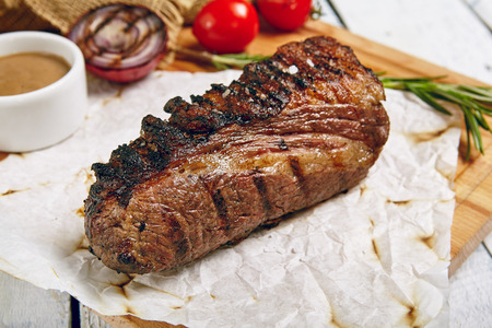 Gourmet Grill Restaurant Steak Menu - Tri-Tip Beef Steak on Wooden Background. Black Angus Prime Beef Steak. Beef Steak Dinner