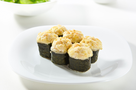 Hot Maki Sushi - Sushi Roll Topped with Baked Cheese. Nori outside