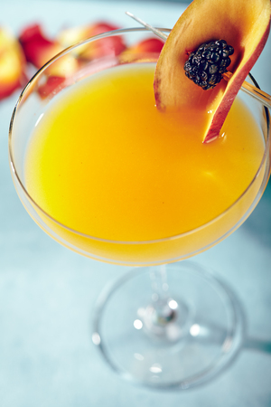 passion fruit flower: Summer  Cocktail -  Pornstar Martini. Drink with Passion fruit, Vodka, Liquor, Vanilla Syrup, Champagne and Lime Juice. Tropical Leaf on Background Stock Photo