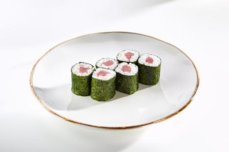 tekka: Classic tuna maki rolls served on white flat plate. Asian menu for gourmets in luxury restaurant