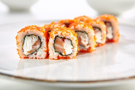 tekka: California rolls with crab meat, Philadelphia cheese served on white flat plate. Asian menu for gourmets in luxury restaurant