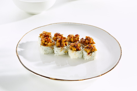 tekka: Baked rolls with tamagoyaki and rice on  white plate with gold border. Asian restaurant menu