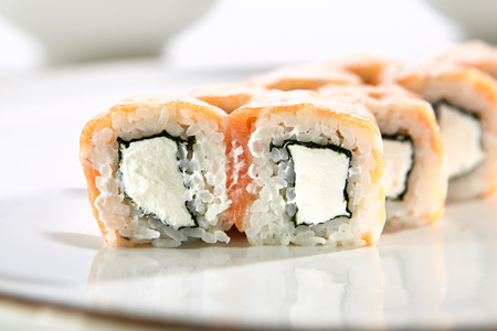 Philadelphia Classic rolls with salmon and Philadelphia cheese served on white flat plate. Asian menu for gourmets in luxury restaurant Stock Photo - 85643054