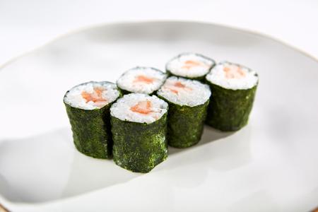 tekka: Classic salmon maki rolls served on white flat plate. Asian menu for gourmets in luxury restaurant