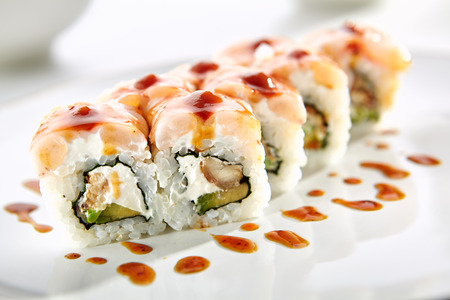 tekka: Katei rolls with shrimp, eel, Philadelphia cheese and avocado served on white flat plate. Asian menu for gourmets in luxury restaurant Stock Photo