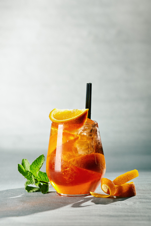 Aperol syringe with orange and mint in  beautiful glass goblet