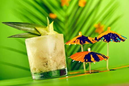 Summer Tropical Cocktail - Mai Tai Cocktail. Summer Beach Cocktail Concept. Tropical Leaves on Background Stock Photo