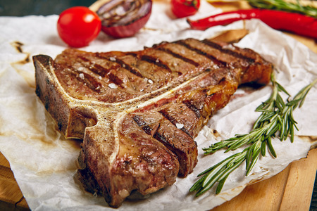Gourmet Grill Restaurant Steak Menu - T-Bone Beef Steak on Wooden Background. Black Angus Prime Beef Steak. Beef Steak Dinner Stock fotó