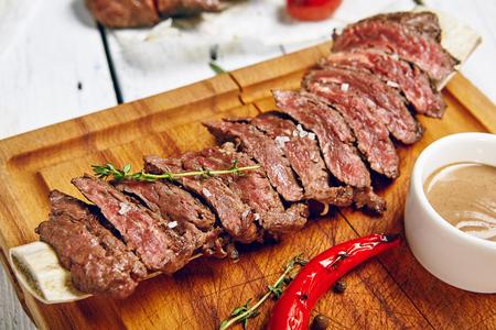 Gourmet Grill Restaurant Beef Steak Menu - Skirt Steak on Wooden Plate. Black Angus Beef Steak. Beef Steak Dinner Stok Fotoğraf