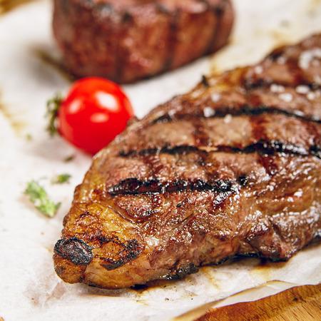 kansas: Gourmet Grill Restaurant Steak Menu - New York Beef Steak on Wooden Background. Black Angus Prime Beef Steak. Beef Steak Dinner. Top VIew