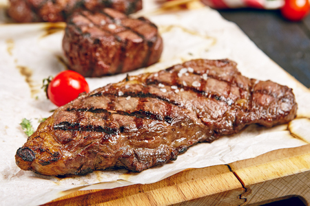 Gourmet Grill Restaurant Steak Menu - New York Beef Steak on Wooden Background. Black Angus Prime Beef Steak. Beef Steak Dinner. Top VIew
