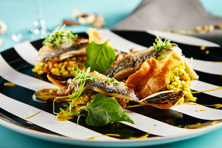 Gourmet Food - Fried Fish with Curry Risotto Stock Photo