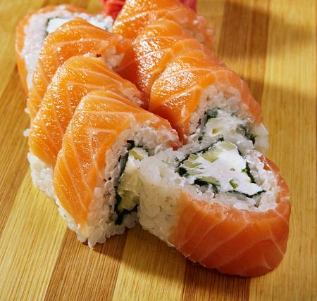 Philadelphia Sushi Roll - Maki Sushi with Philadelphia Cheese inside. Salmon outside