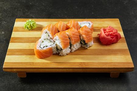 Philadelphia Sushi Roll - Maki Sushi with Philadelphia Cheese inside. Salmon outside Stock Photo - 102910124